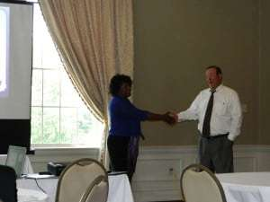 Patrice Moody enlisted fellow presenter Brian Miller to demonstrate the Positive Approach.